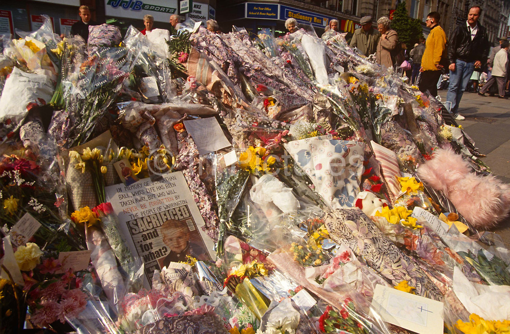 The floral memorial shrine in memory of two young victims killed by an IRA bomb in the centre of Warrington, Cheshire, England, on 27th February 1993, in Warrington, England. Two small bombs exploded in litter bins outside a Boots store and a McDonalds restaurant, killing two children and injuring many other people. Although a warning or warnings had been sent, the area was not evacuated in time. Both attacks were perpetrated by the Provisional Irish Republican Army IRA. Three-year-old Johnathan Ball died at the scene, while his babysitter survived. The second victim, 12-year-old Tim Parry, who received the full force of the blast, was gravely wounded but died weeks later.