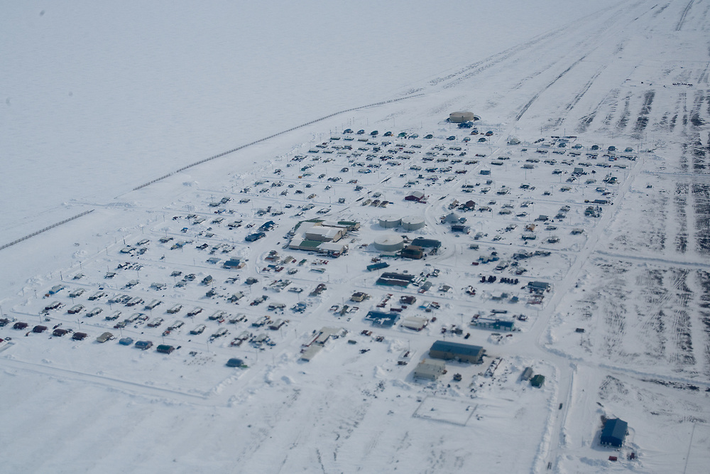 Pack ice extends out  into the Chukchi Sea near the Iñupiaq village of Point Hope, Alaska,