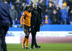 Wolves Manager Nuno Espirito celebrates victory with Bright Enobakhare at full time of the Sky Bet Championship match at the Madejski Stadium, Reading.