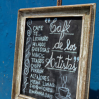South America, Argentina, Buenos Aires. La Boca Menu board for Cafe de los Artistas.