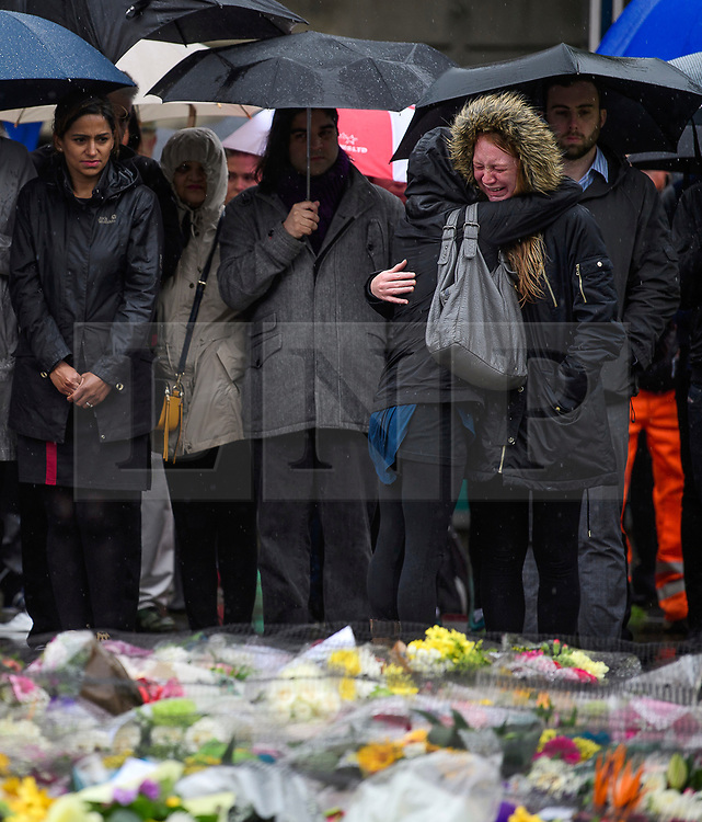 © Licensed to London News Pictures. 06/06/2017. London, UK.  Nicola Smith (far right) the ex-girlfriend of attack victim James McMullan, is comforted by her sister during a minutes silence at London Bridge in central London for those who lost their life in a terrorist attack on Saturday evening. Three men attacked members of the public  after a white van rammed pedestrians on London Bridge.   Ten people including the three suspected attackers were killed and 48 injured in the attack. Photo credit: Ben Cawthra/LNP