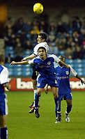 Photo. Chris Ratcliffe<br />Millwall v Derby County. FA Nationwide 1st Division. 22/11/2003<br />Adam Bolder of Derby and Tim Cahill of Millwall go up for the ball