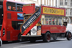 Old fashioned bus in the City of London, UK July 2016
