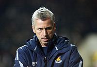 Photo: Chris Ratcliffe.<br />West Ham United v Wigan Athletic. The Barclays Premiership. 28/12/2005.<br />Alan Pardew looks glum after a dismal first half performance.