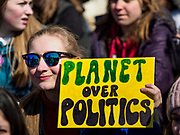 "15 MARCH 2019 - ST. PAUL, MINNESOTA, USA: A high school student holds a ""Planet Over Politics"" sign during the MN Youth for Climate Justice ""Climate Strike"" at the Minnesota State Capitol in St. Paul, MN. Thousands of high school students braved below freezing temperatures and biting winds to demand action on climate change. The Minnesota Climate Strike was inspired by the strike by Greta Thunberg, a Swedish high school student, who started a climate strike at her school in August 2018.        PHOTO BY JACK KURTZ"