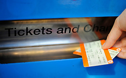 "File photo dated 11/01/16 of a person buying a train ticket. Rail fares are set to ""rocket"" next year, with European owners of UK train services ""robbing"" passengers to hold down their domestic prices, a new study claims."