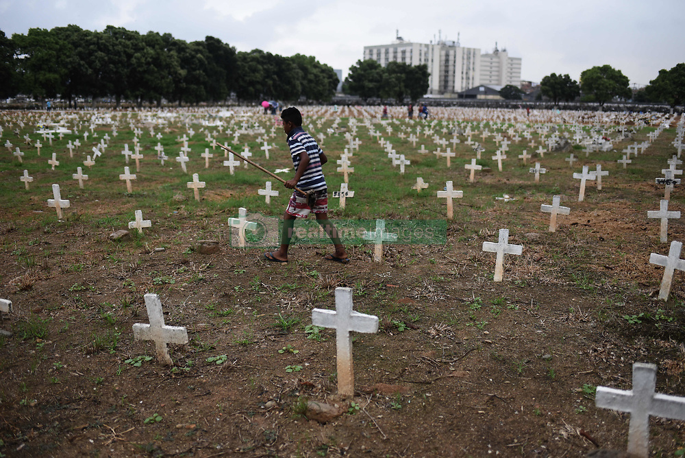 November 2, 2018 - Rio de Janeiro, Brazil - A Boy cleans graves in the Caju Cemetery, North Zone of the city, during the day of the dead. (Credit Image: © Fabio Teixeira/ZUMA Wire)