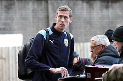 Burnley's Peter Crouch signs autographs for fans as arrives at the stadium prior to the match
