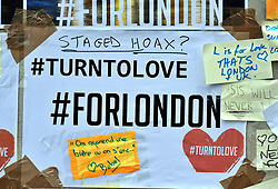 A message of support, with added graffiti, left on the base of the obelisk on London Bridge, following the terror attack in which eight people died.