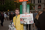 Occupy Wall Street Protester in New York City's in Zuccotti Park holding up their newspaper publication.