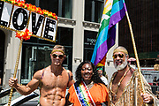 New York, NY - 30 June 2019. The New York City Heritage of Pride March filled Fifth Avenue for hours with participants from the LGBTQ community and it's supporters. Grand Marshall Phyll Opoku Gyimah with two march participants.