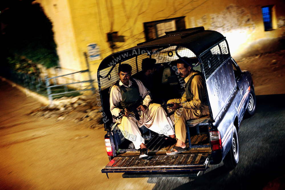 Armed members of the AVCC, (Anti-Violence Crime Cell) a special police unit mostly involved in anti-terrorism operations and kidnap cases in the city of Karachi, are riding their vehicles in the city on their way to a night raid.