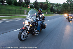"""Michael """"MJ"""" Jones riding out to Vanessa's Corner Pub in Westminster, MD with the Flying Eagles MC (founded 1950). USA. August 14, 2015.  Photography ©2015 Michael Lichter."""