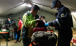 03.10.2015, Grenzübergang, Salzburg - Freilassing, GER, Flüchtlingskrise in der EU, im Bild die Flüchtlinge werden von Polizisten bei Ihrer Ankunft in Deutschland auf gefährliche Gegenstände überprüft und registriert // the refugees are checked by police on arrival in Germany on dangerous objects and they will be registered. Europe is dealing with its greatest influx of migrants and asylum seekers since World War II as immigrants fleeing war and poverty in the Middle East, Afghanistan and Africa try to reach Germany and other Western European countries, Austrian - German Border, Freilassing, Germany on 2015/10/03. EXPA Pictures © 2015, PhotoCredit: EXPA/ JFK