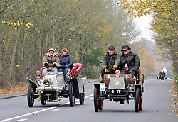 ©London News pictures...07/11/2010. On a freezing morning in Redhill, Pre 1905 four-wheeled cars, tricars and motor tricycles take part in the 77th London to Brighton Veteran Car Run (LBVCR). Representing 24 nations, 572 entries were received for this year's LBVCR, the world's longest running motoring event