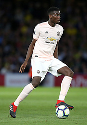 """Manchester United's Paul Pogba during the Premier League match at Vicarage Road, Watford PRESS ASSOCIATION Photo. Picture date: Saturday September 15, 2018. See PA story SOCCER Watford. Photo credit should read: Nigel French/PA Wire. RESTRICTIONS: EDITORIAL USE ONLY No use with unauthorised audio, video, data, fixture lists, club/league logos or """"live"""" services. Online in-match use limited to 120 images, no video emulation. No use in betting, games or single club/league/player publications."""