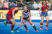 Surbiton's Hannah Martin is watched by Harriet Mitchell of Buckingham. University of Birmingham v Surbiton - Semi-Final - Investec Women's Hockey League Finals, Lee Valley Hockey & Tennis Centre, London, UK on 22 April 2017. Photo: Simon Parker