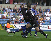 Photo:Alan Crowhurst.Digitalsport<br /> Millwall v Leicester City 14/08/04 Coca-Cola Championship.Jody Morris gets between 2 Leicester defenders to open the scoring for Millwall.
