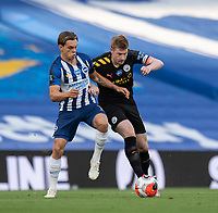 Brighton & Hove Albion's Leandro Trossard (left) battles for possession with Manchester City's Kevin De Bruyne (right) <br /> <br /> Photographer David Horton/CameraSport<br /> <br /> The Premier League - Brighton & Hove Albion v Manchester City - Saturday 11th July 2020 - The Amex Stadium - Brighton<br /> <br /> World Copyright © 2020 CameraSport. All rights reserved. 43 Linden Ave. Countesthorpe. Leicester. England. LE8 5PG - Tel: +44 (0) 116 277 4147 - admin@camerasport.com - www.camerasport.com