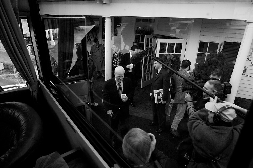 MCCAIN -- Senator John McCain campaigns in New Hampshire - 12/7/99 - Senator John McCain gets ready to board his campaign bus in Meredith, New Hampshire Tuesday morning after speaking at a town hall meeting there.