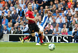 Manchester United's Luke Shaw (left) and Brighton & Hove Albion's Anthony Knockaert (right) battle for the ball during the Premier League match at the AMEX Stadium, Brighton.