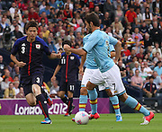Men's Olympic Football match Spain v Japan on 26.7.12...Lopez Adrian of Spain watched by Takahiro Ohgihara of Japan, during the Spain v Japan Men's Olympic Football match at Hampden Park, Glasgow...Picture John Millar / ProLens PhotoAgency / PLPA.Thursday 26th July 2012......................