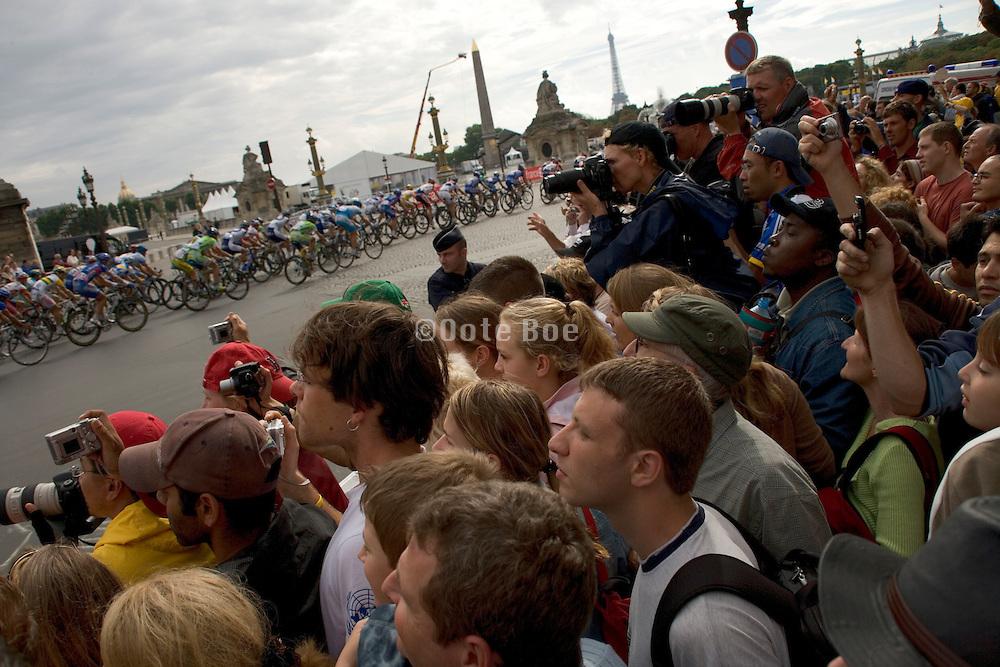 Tour de France Paris. 2005. Last corner for the finish. Public is anxious to photograph there favorite cyclist.