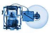 A Kodak Reflex Synchro model camera with flash bulb is shown in X-ray.