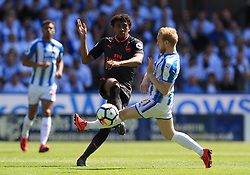 Arsenal's Alex Iwobi (left) and Huddersfield Town's Alex Pritchard in action during the Premier League match at the John Smith's Stadium, Huddersfield.