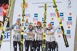 28.02.2021, Oberstdorf, GER, FIS Weltmeisterschaften Ski Nordisch, Oberstdorf 2021, Mixed Teambewerb, Skisprung HS106, Siegerehrung, im Bild Weltmeister und Goldmedaillen Gewinner Karl Geiger (GER), Anna Rupprecht (GER), Markus Eisenbichler (GER), Katharina Althaus (GER) // during the winner ceremony for the ski jumping HS106 mixed team competition of FIS Nordic Ski World Championships 2021 in Oberstdorf, Germany on 2021/02/28. EXPA Pictures © 2021, PhotoCredit: EXPA/ JFK