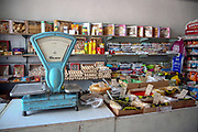 Kyzyl-Oi village (red village or red bowl), Kyrgyzstan. Interior of a grocery store with an old style balance scale