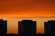 The sunset over blocks of flats in North London, UK. These Ex-local Authority flats are on Bethune Road, Stamford Hill, Hackney.