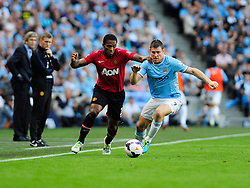 Manchester United's Luis Antonio Valencia challenges Manchester City's James Milner - Photo mandatory by-line: Dougie Allward/JMP - Tel: Mobile: 07966 386802 22/09/2013 - SPORT - FOOTBALL - City of Manchester Stadium - Manchester - Manchester City V Manchester United - Barclays Premier League