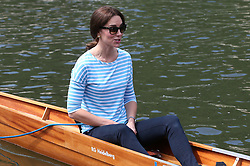 The Duchess of Cambridge gets ready to take part in a rowing competition on the River Neckar during their visit to Heidelberg on the second day of their three-day tour of Germany.