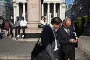 City workers in suits in the City of London, England, United Kingdom. The City of London is a historic financial district.