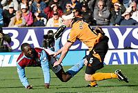 Photo: Steve Bond/Richard Lane Photography. Wolverhampton Wanderers v Aston Villa. Barclays Premiership 2009/10. 24/10/2009. Emile Heskey (L) is fouled by Jody Craddock (R)
