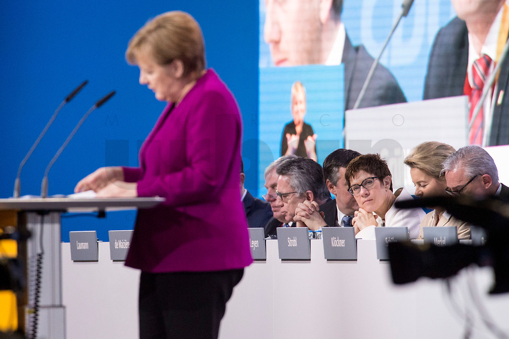 26 FEB 2018, BERLIN/GERMANY:<br /> Annegret Kramp-Karrenbauer (R), CDU, desig. Generalsekraetrin, waehrend der Rede von Angela Merkel, CDU, Bundeskanzlerin, zur Eroeffnung des Parteitages, CDU Bundesparteitag, Station Berlin<br /> IMAGE: 20180226-01-025<br /> KEYWORDS: Party Congress, Parteitag, speech