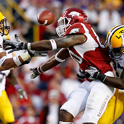 November 25, 2011; Baton Rouge, LA, USA;  LSU Tigers linebacker Karnell Hatcher (37) forces Arkansas Razorbacks tight end Chris Gragg (80) to fumble as cornerback Tyrann Mathieu (7) grabs the ball out of the air during the fourth quarter of a game at Tiger Stadium. LSU defeated Arkansas 41-17. Mandatory Credit: Derick E. Hingle-US PRESSWIRE
