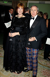 SIR JACKIE & LADY STEWART at the Dyslexia Awards Dinner attended by HRH The Countess of Wessex held at The Dorchester Hotel, Park Lane, London on 9th November 2005.<br />