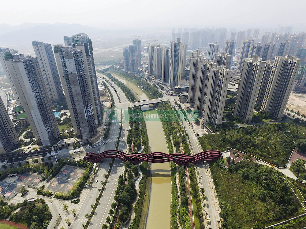 September 22, 2016 - Changsha, China - The Chinese knot bridge on foot which been selected as one of the sexiest buildings by CNN in the world built completely in Changsha,Hunan,China on 22nd September 2016..Credit: Topphoto/face to face.- No rights for China and Taiwan  (Credit Image: © face to face via ZUMA Press)