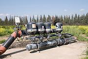 Israel, Hula Valley, Kibbutz Hulata, Citrus orchard, A computerized irrigation system
