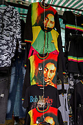 The face of Jamaican Jamaican singer-songwriter Reggae star, Bob Marley printed on clothing at Elephant and Castle shopping centre, on 29th March, 2018 in London, England.
