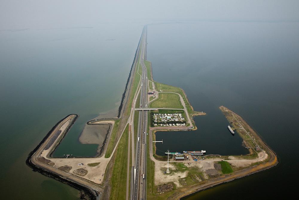 Nederland, Friesland, Gemeente Wonseradeel, 28-04-2010; Afsluitdijk ter hoogte van Breezanddijk, (voormalig werkeiland Breezand). Gezien naar de Friese kust, IJsselmeer  (r), Waddenzee (li)..Enclosure Dam at the height of Breezanddijk (former 'work island' Breezand), seen in the direction of the Frisian coast, IJsselmeer lake (r), the Wadden Sea (l)..luchtfoto (toeslag), aerial photo (additional fee required).foto/photo Siebe Swart