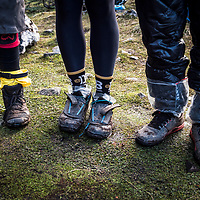 Three mountain bikers try to protect their feet from the wet while exploring the most southern trail in the world on Navarino Island, Chile.