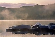 Row boats on dock at sunrise, Lafayette Reservoir, Lafayette, Contra Costa County, CALIFORNIA