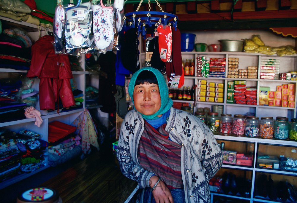 A woman storekeeper in a general store in Bhutan