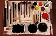 Still life of brushes, paints, inks, and signature stamps in Calligraper's beijing studio, China