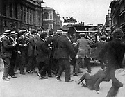 Cheering crowd surrounding the car of Mr Asquith, the British Prime Minister.