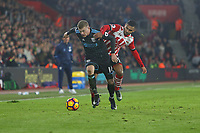 Football - 2016 / 2017 Premier League - Southampton vs. West Bromwich Albion<br /> <br /> Southampton's Sofiane Boufal tries to stop James McClean of West Bromwich Albion from setting up an attack at St Mary's Stadium Southampton England<br /> <br /> COLORSPORT/SHAUN BOGGUST
