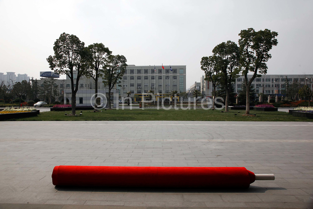 A red carpet is rolled out in anticipation to the arrival of Richard Daley, Mayor of Chicago, at Wanxiang Group's electric automobile division in Hangzhou, Zhejiang Province, China on 25 March, 2011. Wanxiang is China's largest provider of technology for electric cars.